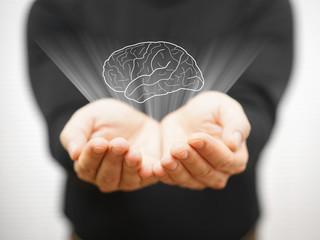man showing virtual brains on open palm, idea concept