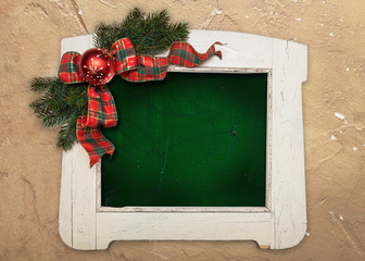 Stylish white colored wooden frame with christmas decoration