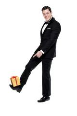 New year's eve fashion man wearing black dinner jacket. Balancin