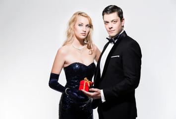 Romantic new year's eve fashion couple wearing black dinner jack