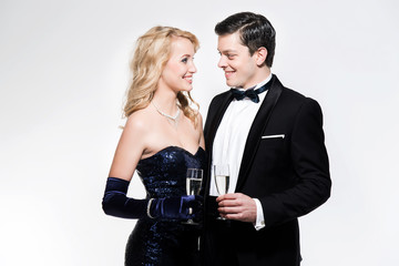 Romantic new year's eve fashion couple toasting with champagne.