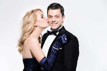 Romantic new year's eve fashion couple. Woman kissing man. Weari