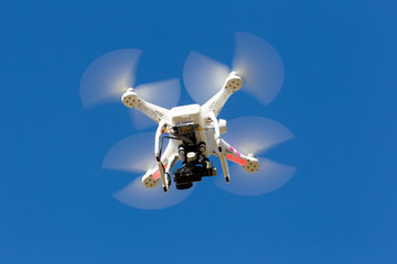 DJI Phantom drone in flight with a mounted GoPro Hero3+ Black Ed