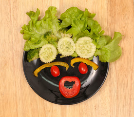 Vegetables on black plate