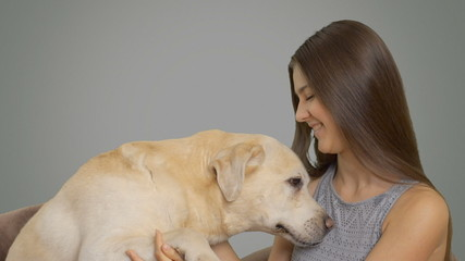 beautiful young girl and tender labrador