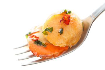fried and spicy scallops with chilli isolated on white