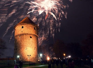 Christmas fireworks near a tower in Tallinn, Estonia