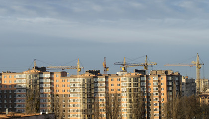 The construction of new apartment blocks in the city with the he