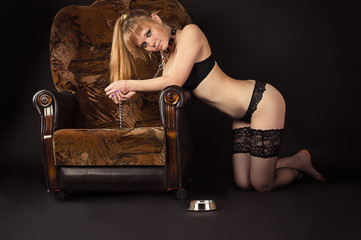 beautiful woman slave kneeling in chair