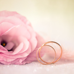 Love Wedding Background with Gold Rings and Beautiful Flower