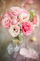 Bright background with roses and feather
