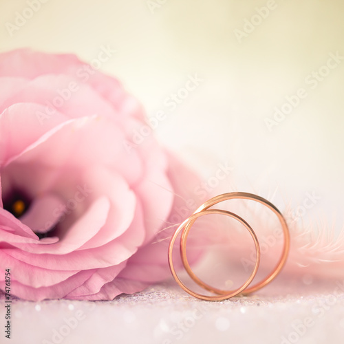canvas print picture Love Wedding Background with Gold Rings and Beautiful Flower