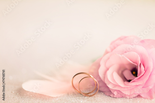 Foto op Canvas Bloemen Wedding Background with gold Rings, gentle flower and light pin