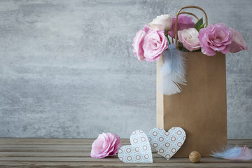 Romantic background with roses and handmade hearts