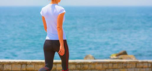 Runner girl - athlete running at seaside, woman fitness