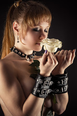 sexy woman slave in handcuffs with flower in hand
