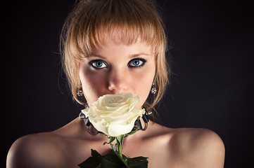 Beautiful face of woman with white rose