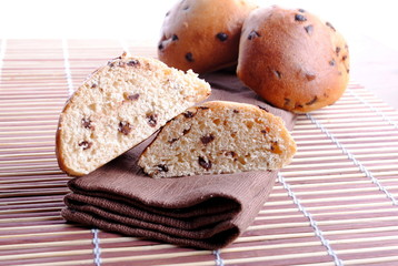 sweet bread with chocolate drops over bamboo placemat