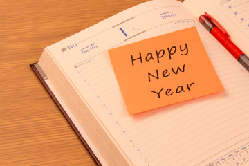 Happy New Year  note on a new year organizer
