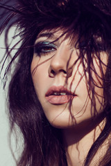 Close up model fashion portrait. Color smoky eyes turquoise.