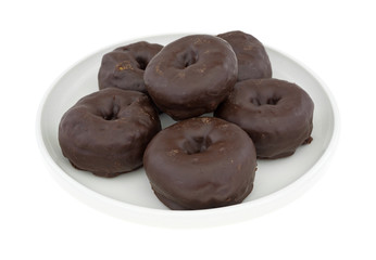 Small chocolate iced donuts on a plate