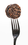 piece of black pudding on fork punctured poster