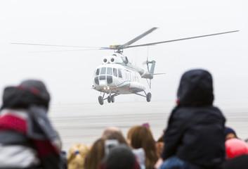 Helicopter mist haze people