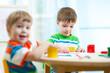 kids painting in daycare or nursery or playschool