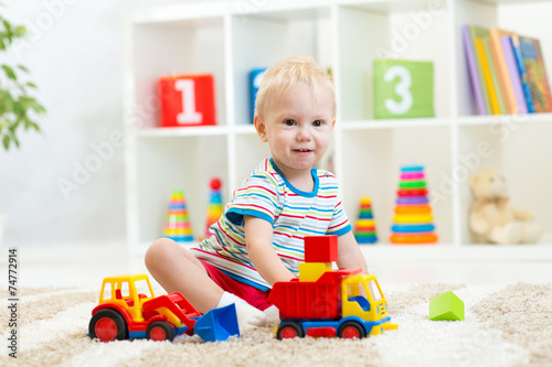canvas print picture kid toddler playing with toy car
