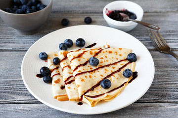 Crepes with chocolate sauce and berries