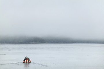 Rescue boat in the ocean with fog. Vancouver. Canada