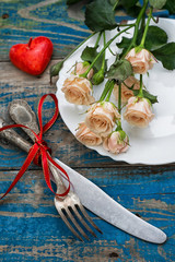 served table and cut roses for Valentine's day