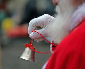 Silver little Bell from Santa Claus with white glove