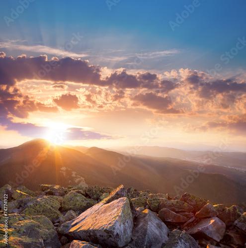 Leinwandbild Motiv Beautiful sunset in the mountains landscape. Dramatic sky and co