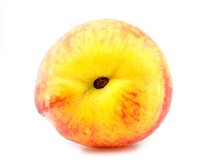 Horizontal view of tasty peach lying on its side