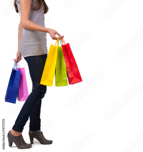 canvas print picture Young woman with shopping bags on white background