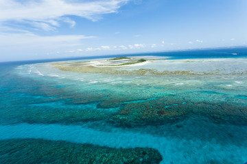 Aerial view of deserted tropical islands and coral reef