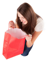 Young woman with shopping bags isolated on white background