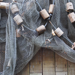 Fishing net is hanging on the wooden wall