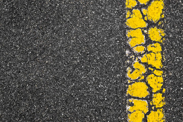 Yellow Road Marking Stripe On Asphalt Background