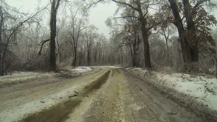 A Point of View (POV) drive in an ice storm in winter