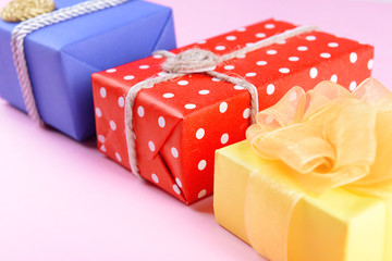 Colorful boxes on pink background