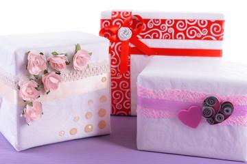 Three cute white present boxes