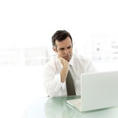 Mature businessman using laptop
