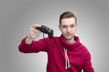 Young slicked back hair man holding game controller