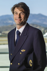 Italy, Sardinia, Olbia Airport, male flight assistant