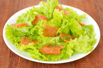 salad with salted salmon on plate
