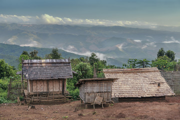 akha village in the mist