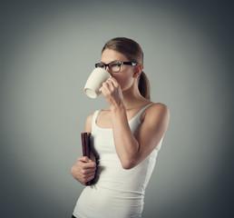 Lovely girl drinking aromatic black coffee. Fast breakfast.