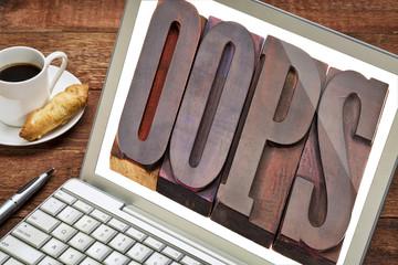 oops word on laptop screen